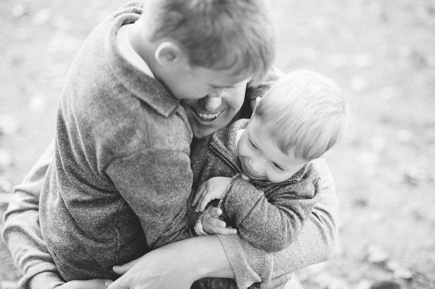 Fathers Cuddle with Sons at Binghamton Park